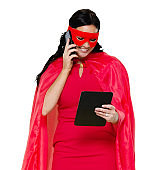 Front view / looking down / one person / waist up / portrait of adult beautiful black hair caucasian female / young women superhero / heroines / hero standing wearing eye mask / mask - disguise / costume / cape - garment / cool attitude
