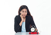 Waist up view of businesswoman holding a time bomb at a desk