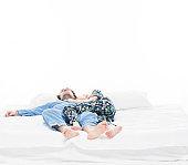 Heterosexual couple lying on bed and sleeping