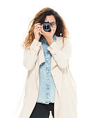 One person / waist up / front view of 30-39 years old adult beautiful brown hair / curly hair / long hair puerto rican ethnicity / latin american and hispanic ethnicity female / young women photographer / photography / tourist standing