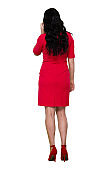 Full length / rear view / back / one person of adult beautiful black hair / long hair caucasian female / young women standing wearing dress and high heels who is talking / cool attitude and holding mobile phone / using smart phone