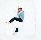 Man resting in bed and sleeping