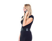 Side view / profile view / one person / waist up of 20-29 years old adult beautiful blond hair / long hair caucasian female / young women businesswoman / business person standing wearing dress / businesswear / a suit and holding mobile phone