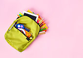 School backpack isolated on pink background