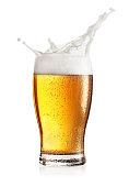 Steamed glass of light beer with splash