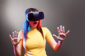 Young girl with VR goggles on head