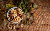 Healthy eating, nuts in a bowl on a rustic background