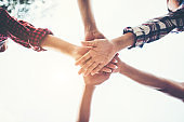 Education people teamwork join hands together