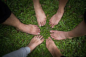 Group of friends with bare feet together.