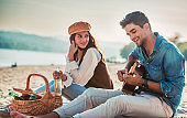 Beautiful young couple having fun on the beach. Lifestyle, love, dating, vacation concept