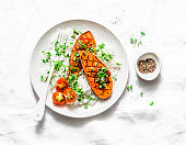 Grilled sweet potatoes with crunchy rice and micro greens on light background, top view. Vegetarian healthy food concept