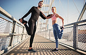 Jogging. Young couple enjoys together in the morning training outdoor. Sport, fitness, recreation concept