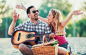 Young couple having fun on the beach. Lifestyle, love, dating, vacation concept