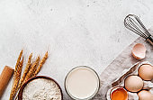 Baking ingredients with a linen tablecloth on marble background
