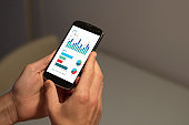 Mobile phone with economic data graph on the screen