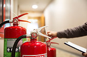 Engineers are inspecting fire extinguisher for prevention and emergency preparedness.