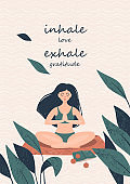 Woman doing yoga in a lotus position on the beach near tropical plants and text Inhale love Exhale gratitude