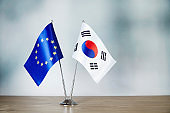 European Union and South Korean flag standing on the table