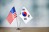 American and South Korean flag standing on the table