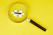 Looking for teamwork with magnifying glass
