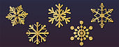 Set of Christmas snowflakes, different shapes. Snowflakes with golden dust and glitter isolated on dark background. Vector 3d illustration, EPS10