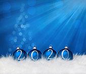2020 Blue Christmas balls on fur and defocused christmas tree lights