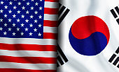 American and South Korean flags standing side by side