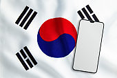 Modern Mobile Phone on Full Frame South Korean Flag