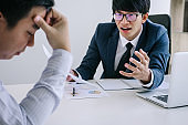 Boss and executive team feeling stress and serious of fail business, Team dispute of failure holding heads in hands with problems with a pile of work, sadness by bad news