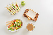homemade sandwich with salad and juice as a healthy breakfast on white