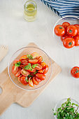 Fresh salad with tomato, mozzarella and basil. Concept for a tasty and healthy appetizer