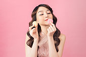portrait of happy asian woman with macaron looking at camera
