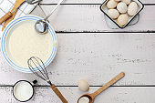 Cooking dough for pancakes. Rustic style, vintage utensils for the kitchen.