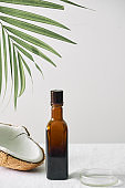 Spa cosmetics in brown glass bottles on gray concrete table. Copy space. Beauty blogger, salon therapy, minimalism concept