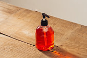 cosmetic bottle isolated on wooden table