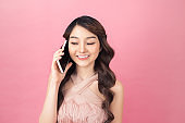 Beautiful of portrait young asian woman talk smart phone and smile