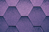 Violet texture surface of roofing tiles. Cover at shape of rhombus. Dark purple roof tile, grunge backgrounds.