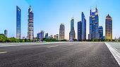 Shanghai modern commercial office buildings and empty asphalt road at night