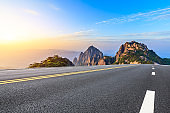 Asphalt highway road and beautiful huangshan mountains nature landscape