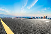 Asphalt road and city skyline at sunrise in hangzhou,high angle view