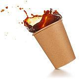 take-out cup of splashing coffee