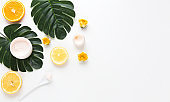 Creative hipster tropical leaves and orange fruit background with copy space on bright background. Tropical concept. flatlay.