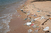 Garbage on the beach, environmental pollution of tropical sea