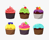 Cupcakes in cartoon flat design isolated on white background. Cute tasty cakes vector colorful illustration.