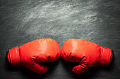 Boxing Gloves on black cement background.