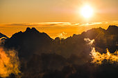 Sun rising over the beautiful mountains and clouds in High Tatras, Slovakia