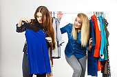 Happy women clothes shopping