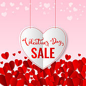 Valentine's Day Sale Text in Hanging White Heart with Red Paper Cut Hearts Decorated on Pink Background for Advertising Concept.