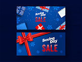 Set of Boxing Day Sale banner design with top view gift boxes and snowflakes decorated on blue background.