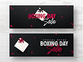 Advertising header or banner set with gift box on black background for Boxing Day Sale.
